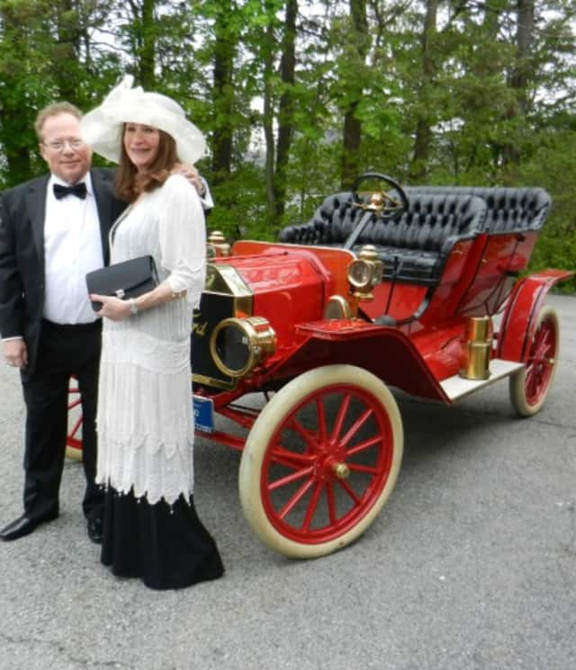 White Plains Historical Society Trustee Howard and Lea Waldman, stand in front of an old Ford during the White Plains Historical Society Centennial Ball.