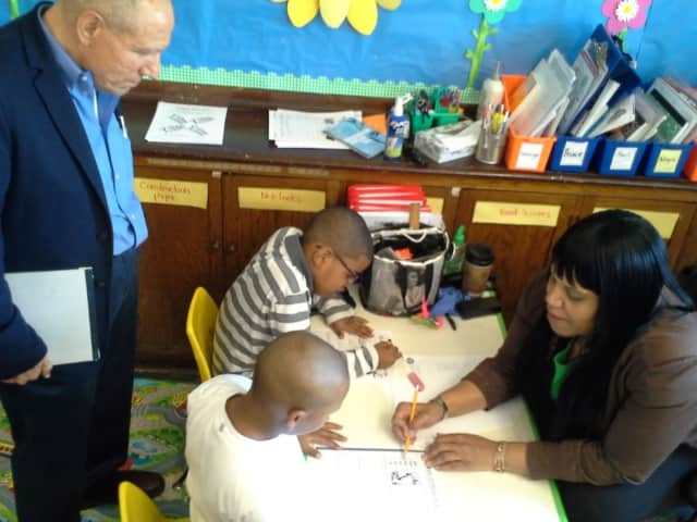 Dr. Vincent J. Carbone, Ed.D. (left), a board-certified behavior analyst and CEO of the internationally renowned Carbone Clinic, visits a classroom at Rebecca Turner Elementary School in Mount Vernon.