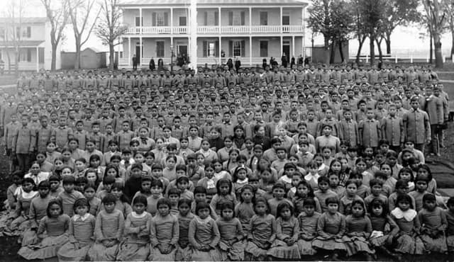 Photo of some of the students at the Carlisle Indian Industrial School, taken sometime between 1879 until 1918.