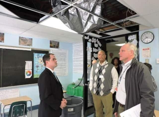 State Sen. David Carlucci tours Ramapo High School with school officials recently to look over the leaky roof situation. The lawmaker said Wednesday that $1 million has been found to make repairs there.