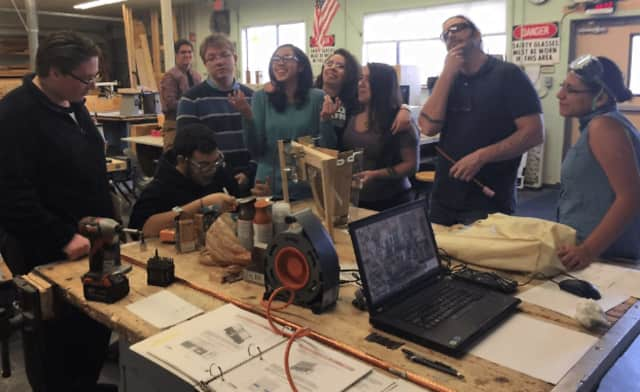 The Bad News Gears, Carmel High School's robotics team, works on the creations they will use in a regional competition next month. If all goes well, they may win a spot in an international tourney in April. Teacher Don Saldicco is second from right.