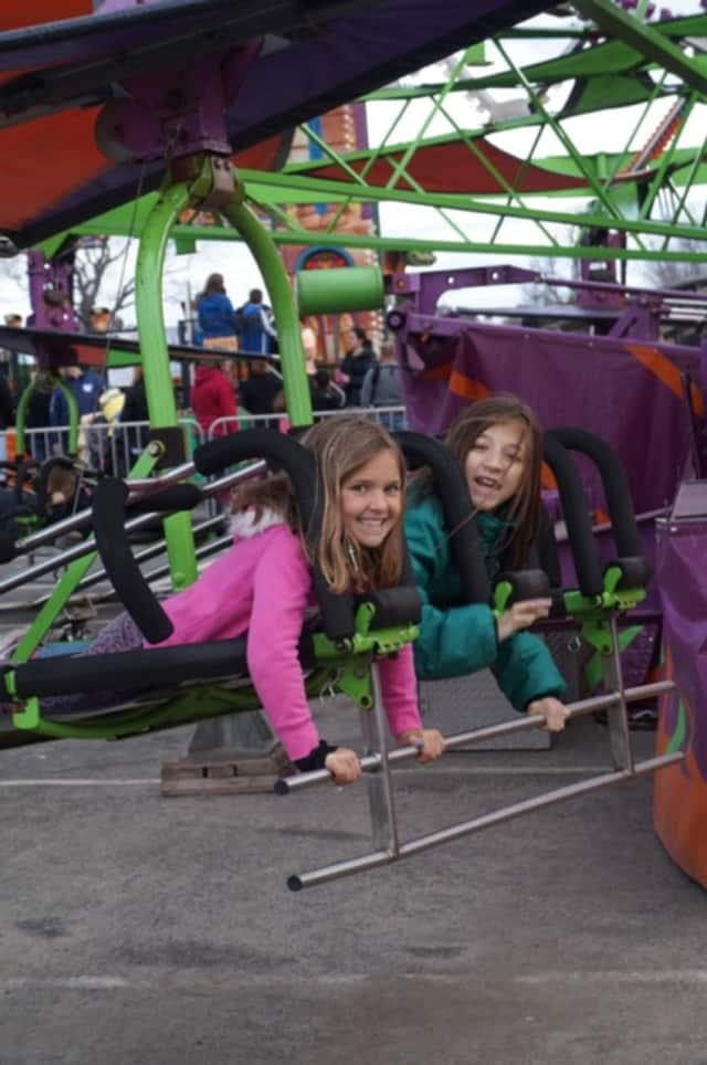 Two thrill seekers prepare to scream at the McKinley School Carnival.