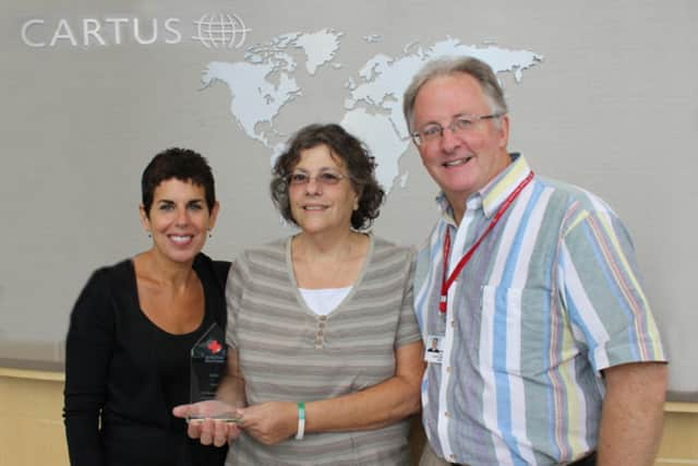 Red Cross Account Manager Lou Cassano of the American Red Cross Connecticut Blood Service presented Amy Meichner, Donna Amiano and Roxanna Cassell (not shown) with its 2014 Top Sponsor Award.