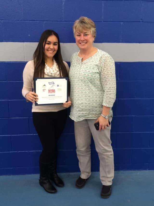 Elmwood Park senior Ashley Barrios, at left, with basketball coach Kim Tanis.
