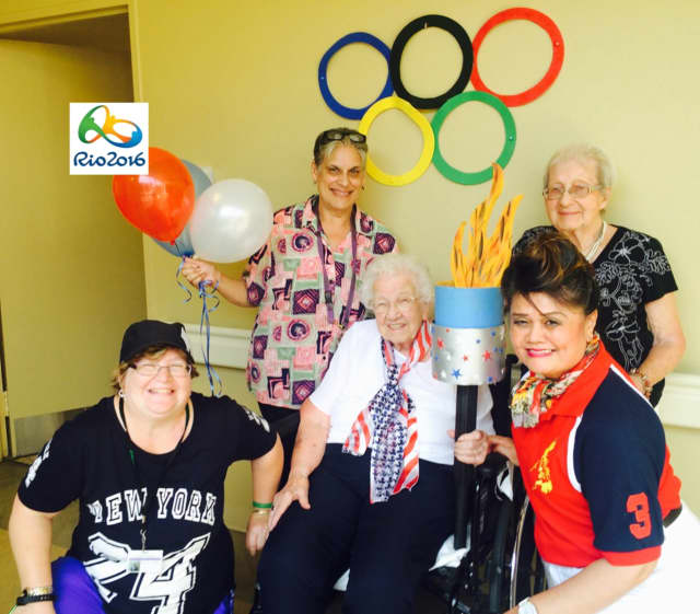 From left, Staci Hickey, Georgina Garcia, Catherine Carpenter, Lucille Lopez and Marilyn Hoermann get into the Olympic spirit.