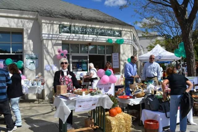 Businesses showcase their wares and services at Somers'  Community Day in 2013. This year's event takes place on Saturday.