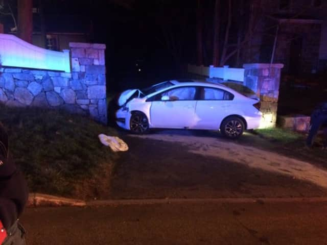 A car slammed into a stone wall late Tuesday on Sound View Drive in Greenwich.