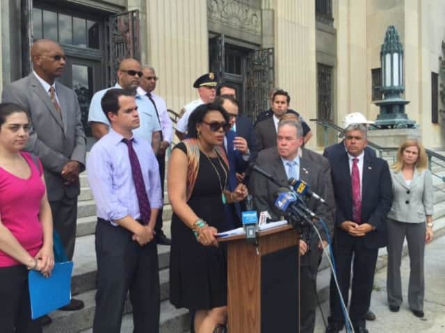 State and local officials speak at a rally following a fire-bombing incident at the homes of two rabbis.