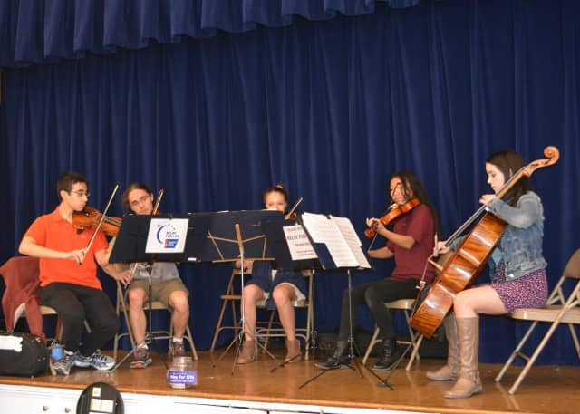 Members of John Jay High School's Chamber Ensemble entertained shoppers at the Chappaqua Farmers Market and collected donations for the upcoming American Cancer Society Relay for Life and Tri-M Music Society.