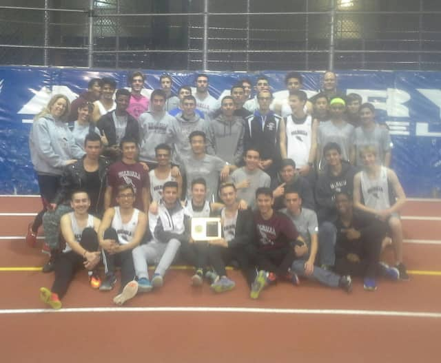 Valhalla High School boys indoor track team hold its award plaque for winning the Sectional Championship on Wednesday.