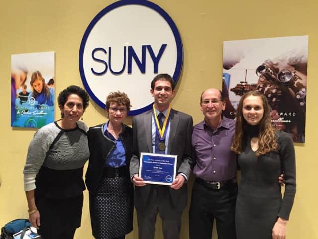 Dylan Rose, center, flanked by Melanie Rose, far left, Director of the New Paltz Honors Program Dr. Patricia Sullivan, Bruce Rose and Chelsea Rose.