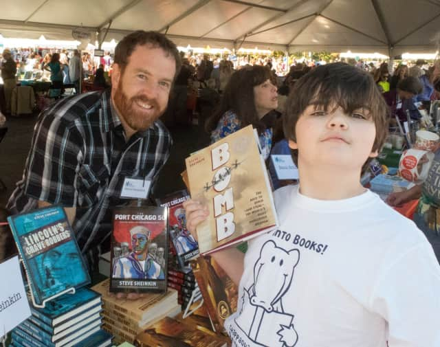 Author Steve Sheinkin with middle schooler Jackson Greenberg at the 2014 Chappaqua Children's Book Festival.