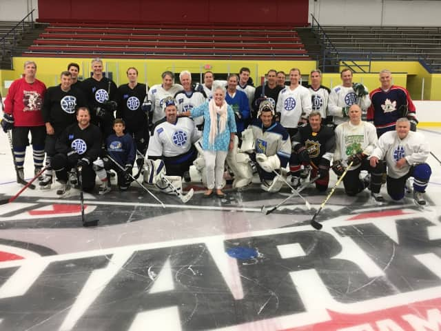 Darien Winter Club 'Charity Skate' Players with P2P Executive Director Ceci Maher