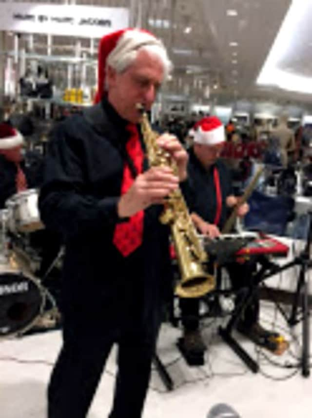 The Broadway Knights entertained holiday shoppers at Lord & Taylor's Channel area Saturday, Dec. 12 at the Garden State Plaza, Paramus. Dr. Charles Marranzano of Cliffside Park is seen here playing sax.