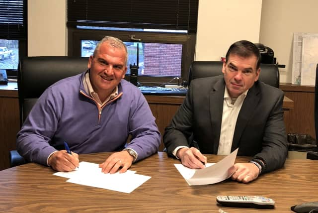 Westport Police Chief Foti Koskinas, left, and Fairfield Police Chief Gary MacNamara sign a letter opposing the Concealed Carry Reciprocity Act.