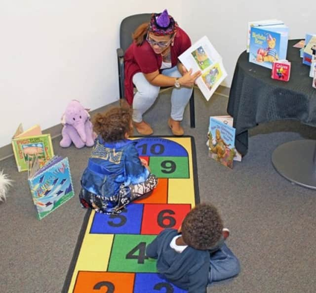 "Children are read to at the Child Care Council of Westchester. The Scarsdale-based nonprofit, which aims to be both a resource and referral service, is raising money via a social media campaign to buy ""Brain-Building Kits."""