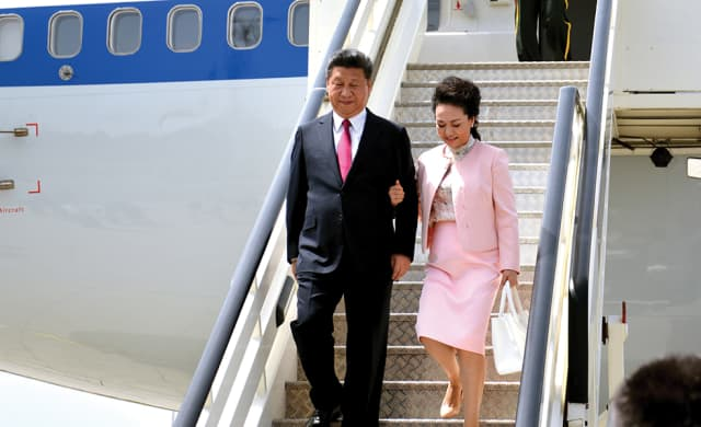 Xi Jinping and wife, folk singer Peng Liyuan, arriving at Nikola Tesla International Airport in Belgrade, Serbia, for a state visit on June 17, 2016. She has described the couple as living a laid-back life in Jade Spring Hill, a private enclave run by the Central Military Commission in northwestern Beijing.