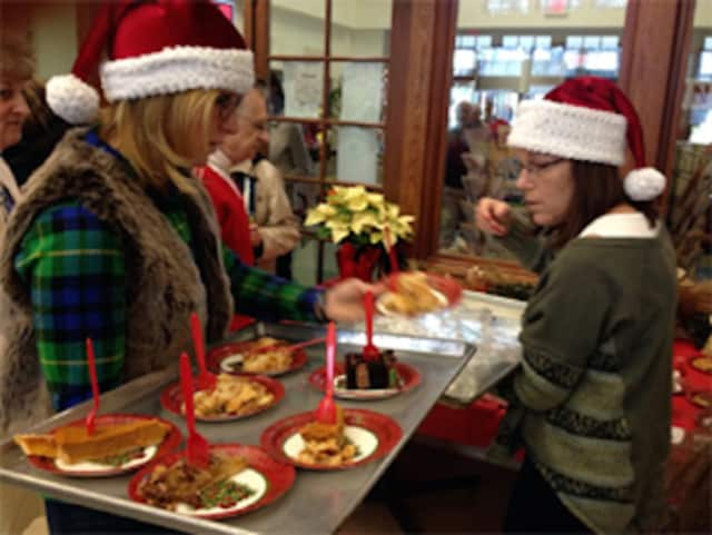 Volunteers will serve up a Christmas luncheon at Saugatuck Congregational Church in Westport on Friday, Dec. 25..