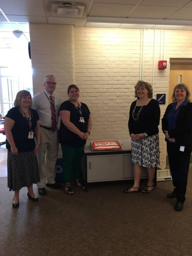 Melissa Fenstermaker, third from left, stands with a cake honoring her selection as the Shelton School District's Teacher of the Year.