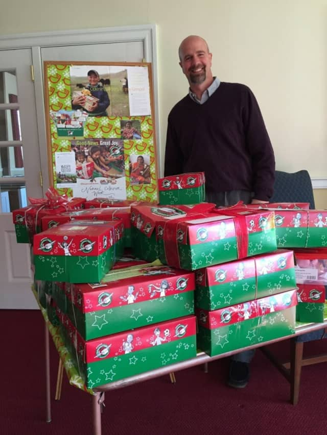 Rev. Steve Sayer and volunteers have organized about 30 boxes for the first donations of Operation Christmas Child, a benefit at Harrington Park Community Church.