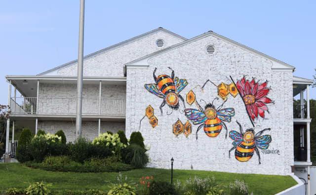 "Frankie Fieri's honeybee-themed mural ""buzzes"" around the Circle Hotel Fairfield through the fall. Courtesy Circle Hotel Fairfield."
