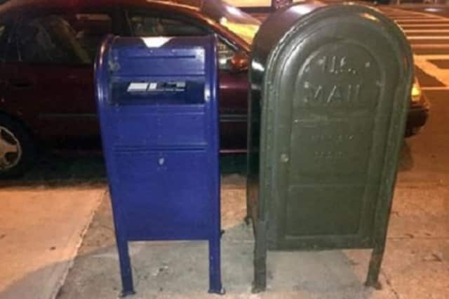 """The U.S. Postal Service is retrofitting its boxes with slots instead of pull-down """"snorkels"""" in an attempt to thwart folks who """"fish"""" for cash or checks in the mail."""
