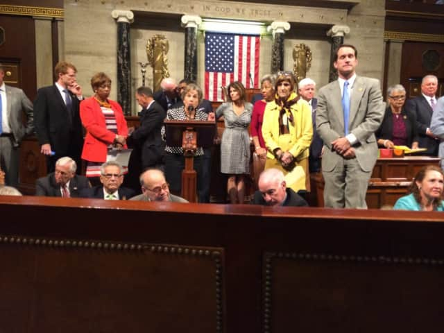 U.S. Rep. Jim Himes, standing right, joins U.S. Rep. Rosa DeLauro, left, and U.S. Rep. Elizabeth Esty, seated, in a sit-in on the floor of the U.S. House.