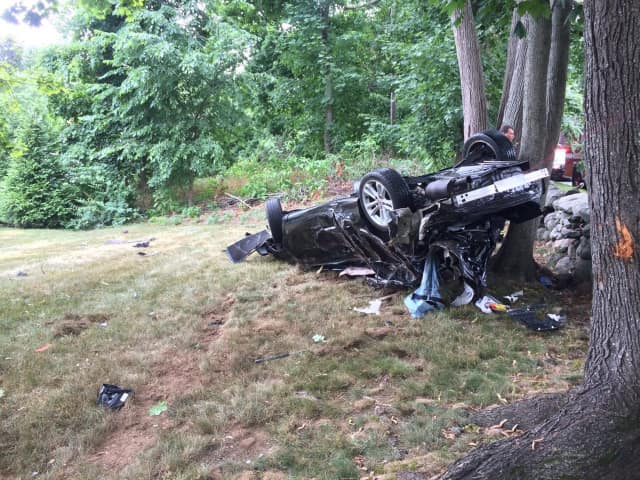 A car slammed into a tree off North Street in Greenwich in a rollover crash on Sunday afternoon.