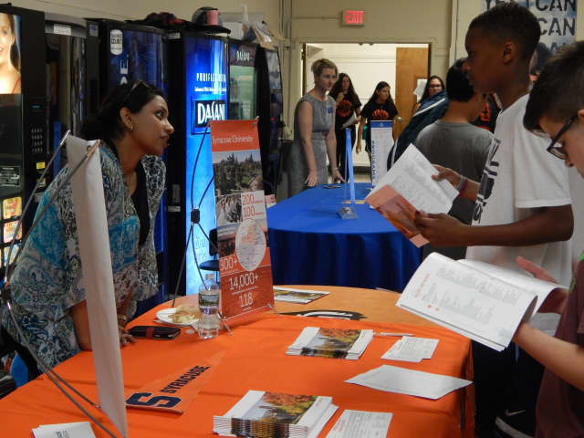 Students meet with a college representative at the Tuckahoe High School college fair.