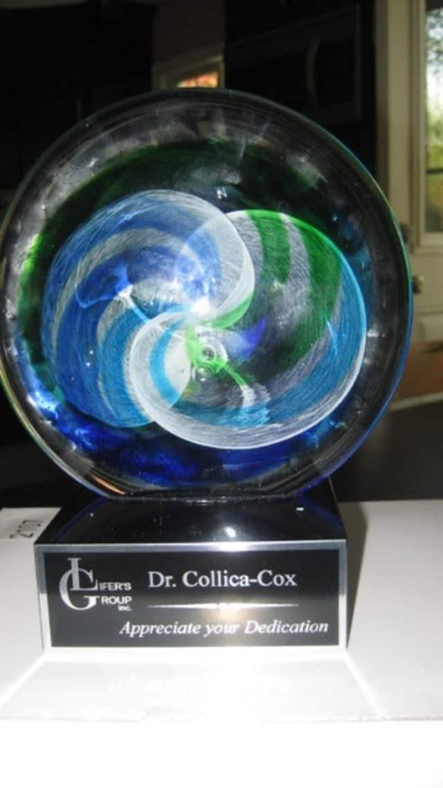 Dr. Kim Collica-Cox received a recognition award from the Lifer's Group, a New Jersey prison-based hip hop group.