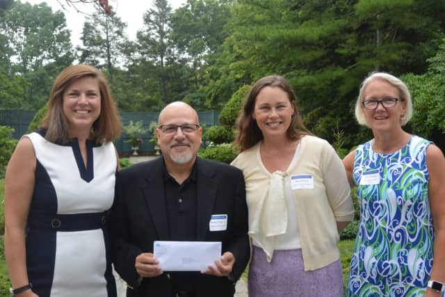 Pictured left to right are Carrie Bernier, executive director of The Community Fund of Darien; Rafael Pagan, Jr., executive director of Pacific House; and Mary Majewski and Amy Wilkinson of The Community Fund of Darien.
