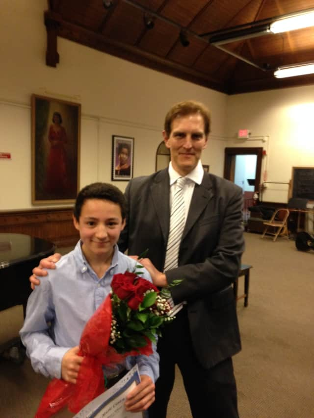 Julian Shively, winner of the 2014 Concerto Competition, with Ariel Rudiakov, conductor of the Danbury Symphony Orchestra. The Danbury Music Centre presents its 14th annual student concerto competition on Saturday, at 2 p.m.