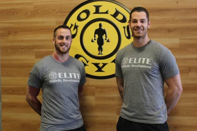 Left to right: Scott Zobre and Corey Phillips work as personal trainers at Gold's Gym Dutchess County.