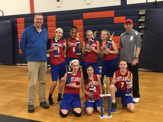 The Cortlandt eighth-grade girls travel basketball team after defeating New Rochelle for the A Division Tri-County Basketball League title.