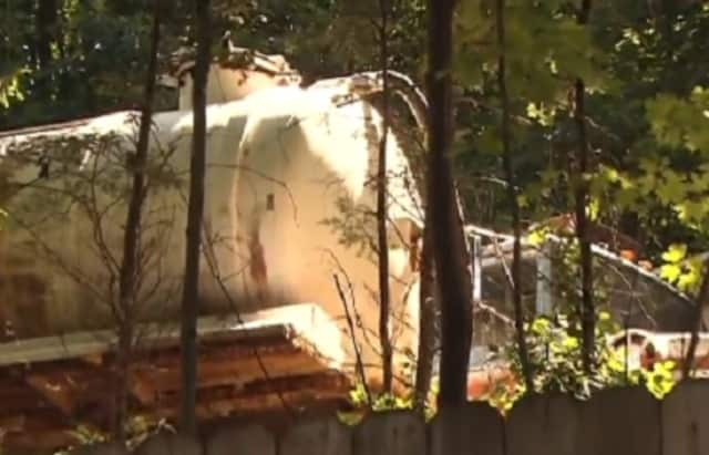 A Cortlandt Manor resident says his neighbor hasn't removed the industrial equipment from his yard, including a rusted septic truck, that he was ordered to remove in 2008.