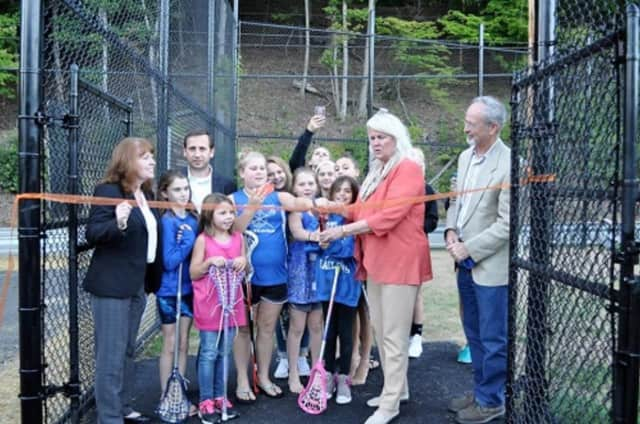 Cortlandt Supervisor Linda Puglisi gets ready to snip the ribbon during the grand opening of the town's new lacrosse field last year. She counts the field among the town's accomplishments for 2016.