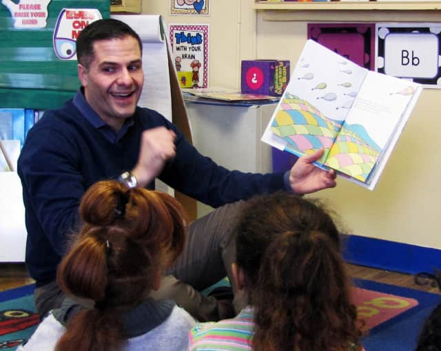 County Executive Marc Molinaro reads to students.