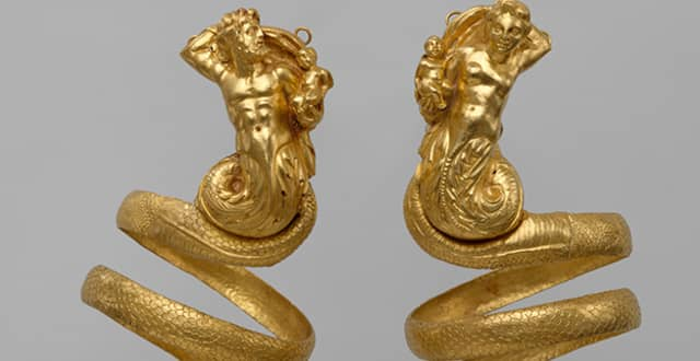 http://www.metmuseum.org/art/collection/search/254842 Greek, Pair of gold armbands, ca. 200 B.C., Gold, Overall: 10 7/16in., 0.4lb. (26.5cm, 0.2kg) Other (height-triton armband): 9 13/16in. (25cm) Other (height-tritoness armband): 10 7/16in. (26.5cm). The Metropolitan Museum of Art, New York. Rogers Fund, 1956 (56.11.5, .6)