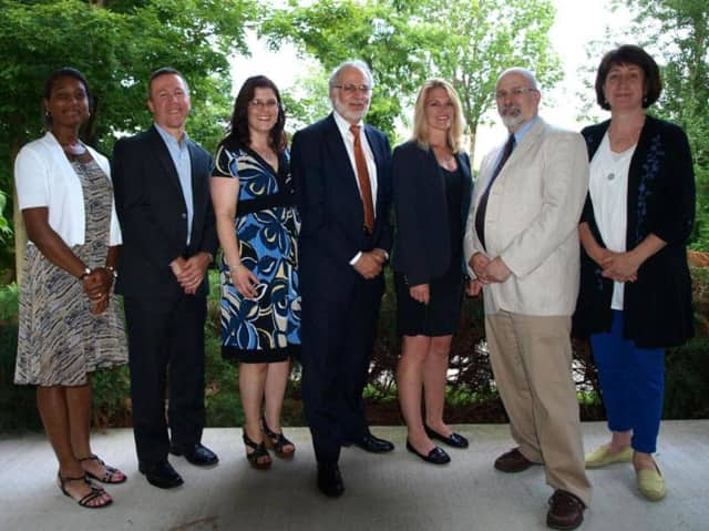 Croton-Harmon school trustees are calling on the state to restore school funding. Board members, l-r: Iris Bugliosi, vice president; Todd Freebern, president; Giuseppina Miller, Neal Haber, Patrice Davidson, Joshua Diamond, and Andrea Furey.