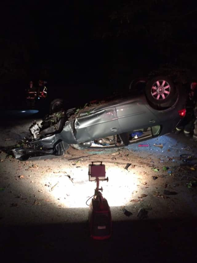 Croton-on-Hudson firefighters rescued a man pinned under a car after a rollover accident Saturday.