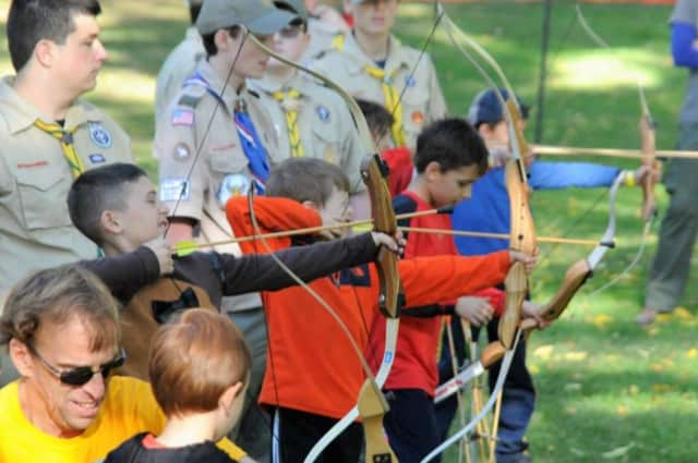 James Ronan, Marc Desforges, and Jacques Desforges show off their archery skills at the Thunderbird Games in Croton Point Park, Croton-on-Hudson, N.Y.