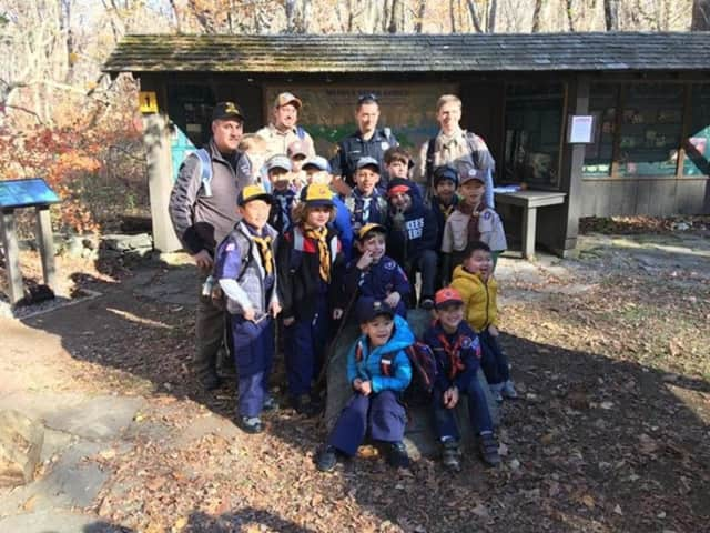Left to right: Bill McCormack, Troop Leader Robert Coppola, Officer Doug Romero, and Troop Leader Chris Desforges along with the Bedford/Pound Ridge Pack 170 Cub Scouts.
