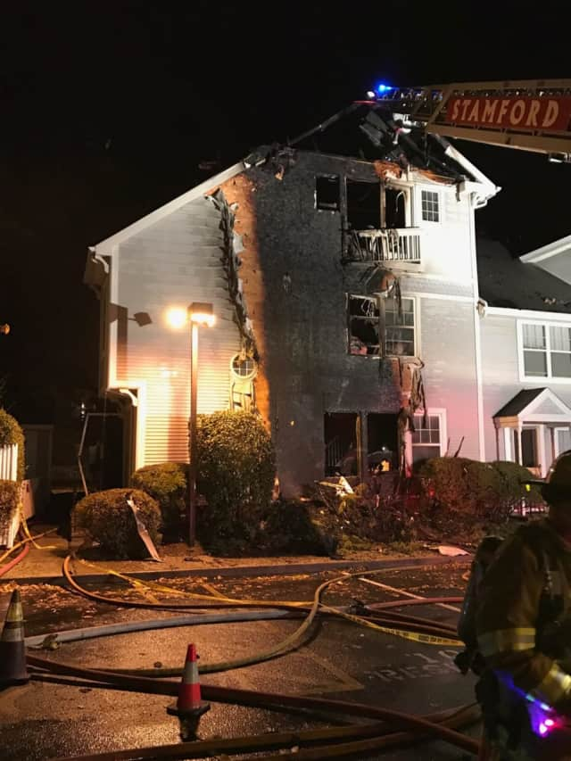 A three-alarm fire heavily damages a condo at 1 Southfield Ave. in Stamford on Wednesday evening.