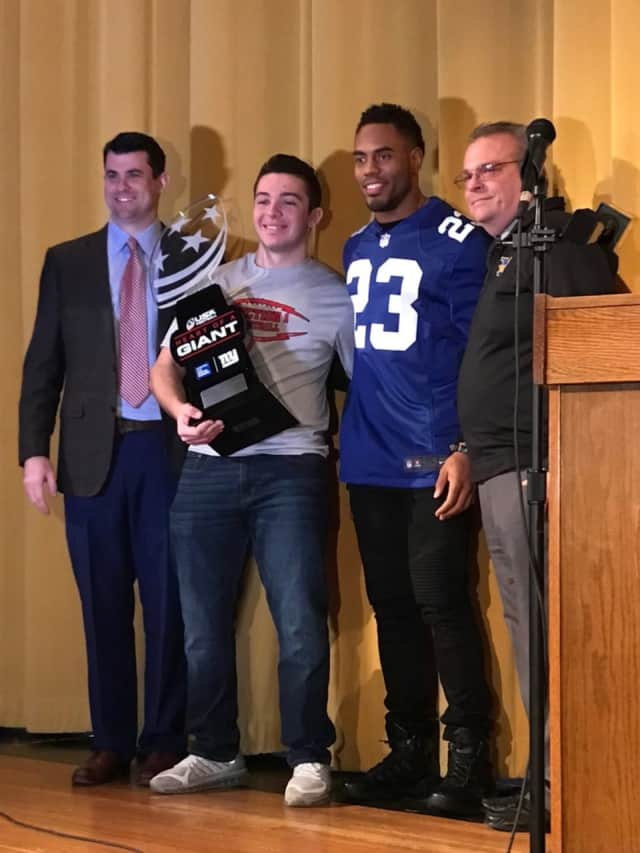 Mahopac High School senior Charlie Burt received USA Football's Heart of a Giant award on Monday.