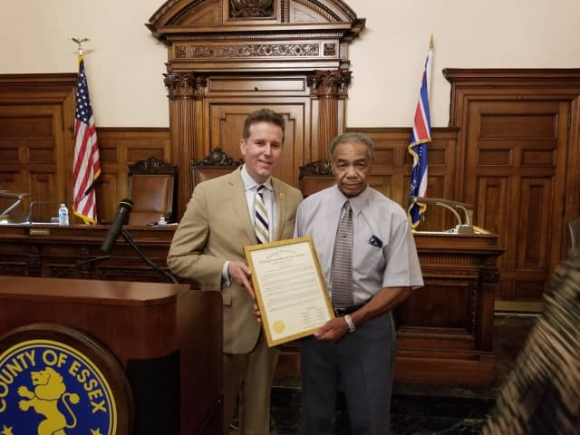 Brendan Gill (left), president of the Essex County Board of Chosen Freeholders, congratulates Willie Sumlar on his retirement. Sumlar has worked for the county for 62 years.