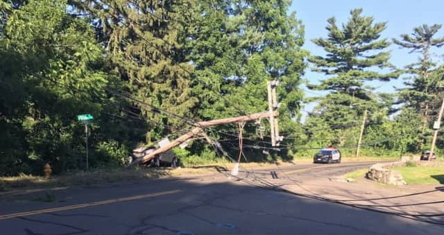 A toppled power pole forced Norwalk police to close Spring Hill late Wednesday afternoon.