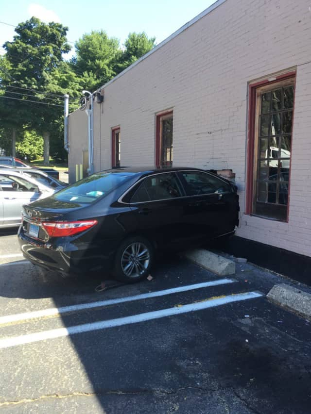 A car slammed right through the brick wall at Styles Salon at 940 Boston Post Road in Milford.