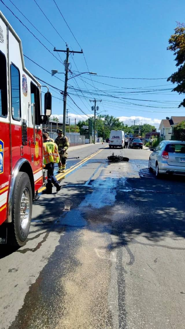 Stamford firefighters respond to a crash on Fairfield Avenue in which a motorcycle burst into flames on Wednesday.