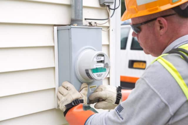 An Orange & Rockland utility worker installs one of the first smart meters in Clarkstown.