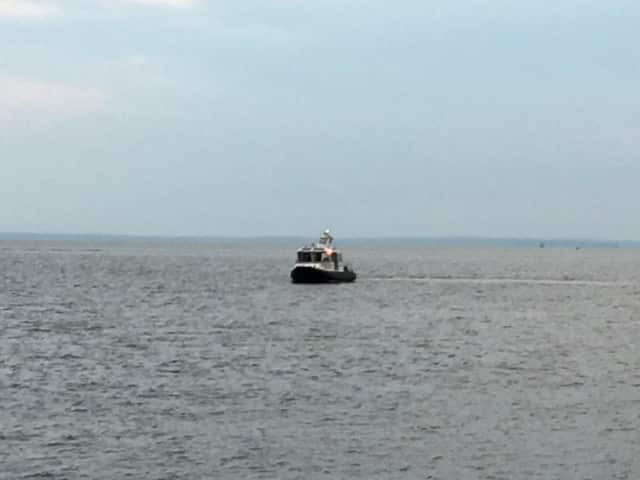 A boat searches the water of Long Island Sound off the coast of Stratford on a report of a possible missing person. The search turned up empty and was believed to be a false alarm.